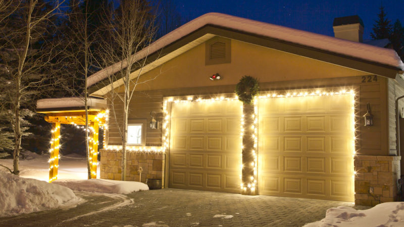 holiday lights around garage doors at night
